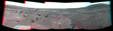 NASA's Mars Exploration Rover Spirit took the images combined to make this stereo view on March 21, 2009. West is at the center, where a dust devil is visible in the distance. 3D glasses are necessary to view this image.