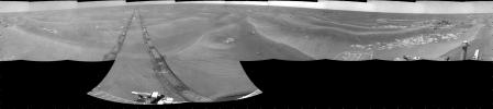 NASA's Mars Exploration Rover Opportunity used its navigation camera to take the images combined into this 360-degree cylindrical view of the rover's surroundings on the 1,950th Martian day, or sol, of its surface mission (July 19, 2009).