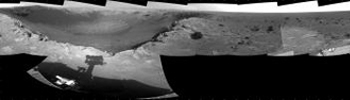 This 360-degree mosaic of images from the navigation camera on NASA's Mars Exploration Rover Opportunity shows the view from the western rim of 'Santa Maria' crater. South is at the center, north at both ends.
