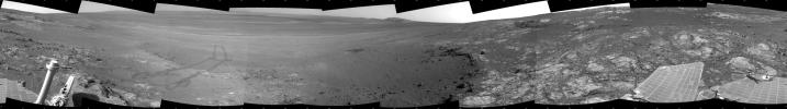 This full-circle panorama shows the terrain around the NASA Mars Exploration Rover Opportunity on part of a relatively flat, light-toned outcrop called 'Whitewater Lake' on Sept. 13, 2012.