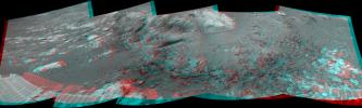 This 180-degree 3-D mosaic of images from the navigation camera on the NASA Mars Exploration Rover Opportunity shows the rover close to the outcrop called 'Copper Cliff,' which is in the center of this scene.