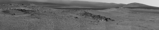 NASA's Opportunity used its Pancam to record this view of the rise in the foreground, called 'Nobbys Head.' This view is centered toward the south-southeast, with Opportunity's next destination, 'Solander Point,' toward the right edge of the view.