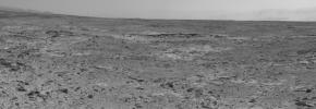 The low ridge that appears as a dark band below the horizon in the center of this scene is a Martian outcrop called 'Cooperstown,' a possible site for contact inspection with tools on the robotic arm of NASA's Mars rover Curiosity.