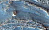 This image captured by NASA's Mars Reconnaissance Orbiter spans from wall to wall across the center area of an impact crater. From what we see, a lot has happened to modify the appearance of the crater since it was formed.