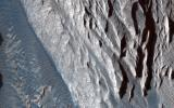 This observation from NASA's Mars Reconnaissance Orbiter shows one of the first close HiRISE views of the enigmatic Valles Marineris interior layered deposits.