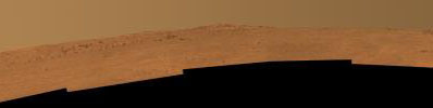 This view toward the south is a mosaic of images taken by Opportunity's Pancam on Dec. 25, 2013. The rover team plans to use Opportunity during 2014 to investigate rock layers exposed on the slope upward toward the McClure-Beverlin Escarpment.