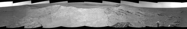 NASA's Mars Exploration Rover capturde this 360-degree view near the ridgeline of Endeavour Crater's western rim. The center is southeastward. Rocks on the slope to the right of center are in an outcrop area targeted for the rover to study.