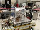 The Optical PAyload for Lasercomm Science (OPALS) is pictured in the Spacecraft Assembly Facility at NASA's Jet Propulsion Laboratory prior to shipment.