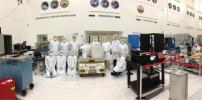 NASA's Optical PAyload for Lasercomm Science (OPALS) integration and test team is seen at NASA's Jet Propulsion Laboratory prior to OPALS shipment to Kennedy Space Center.