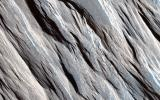 The long straight ridges seen in this image from NASA's Mars Reconnaissance Orbiter are called yardangs and they form on Mars (and Earth) when the wind strips away the inter-ridge material.