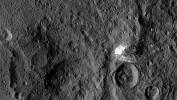 NASA's Dawn spacecraft spotted this tall, conical mountain on Ceres from a distance of 915 miles (1,470 kilometers). The mountain, located in the southern hemisphere, stands 4 miles (6 kilometers) high.