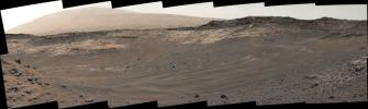 This view southeastward from NASA's Curiosity's Mastcam shows terrain judged difficult for traversing between the rover and an outcrop in the middle distance where a pale rock unit meets a darker rock unit above it.