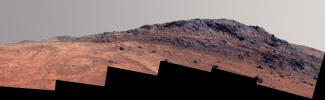 This enhanced color Martian scene from NASA's Mars rover Opportunity shows contrasting textures and colors of 'Hinners Point,' at the northern edge of 'Marathon Valley,' and swirling reddish zones on the valley floor to the left.