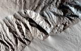 This observation from NASA's Mars Reconnaissance Orbiter spacecraft shows a terrain of relatively smooth region that transitions into sharp ridges called yardangs on Apollonaris Patera.