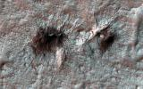 Subtle variations in color look like brush strokes as the lightly frosted terrain reflects light on Mars as seen by NASA's Mars Reconnaissance Orbiter.