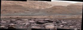 The foreground of this scene from NASA's Curiosity Mars rover shows purple-hued rocks near the rover's late-2016 location on lower Mount Sharp. Variations in color of the rocks hint at the diversity of their composition.