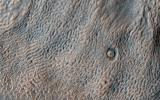 This enhanced color image from NASA's Mars Reconnaissance Orbiter shows the surface of a lobate debris apron in the Deuteronilus Mensae region of Mars, on the boundary between the Northern plains and Southern lowlands.