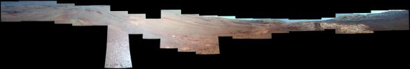 This enhanced-color view from within 'Perseverance Valley,' on the inner slope of the western rim of Endurance Crater on Mars, includes wheel tracks from NASA's Opportunity rover's descent of the valley.