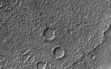 This image from NASA's Mars Reconnaissance Orbiter (MRO) shows Mars' surface in detail. This particular site on Mars was first imaged in 1965 by the Mariner 4 spacecraft during the first successful fly-by mission to Mars.