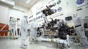 In the clean room of the Spacecraft Assembly Facility at JPL, the Mars 2020 rover's 7-foot-long (2.1-meter-long) arm maneuvers its 88-pound (40-kilogram) sensor-laden turret as it moves from a deployed to a stowed configuration.