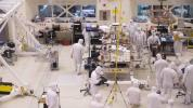 A team of engineers at NASA's Jet Propulsion Laboratory in Pasadena, California, install the legs and wheels on the Mars 2020 rover.